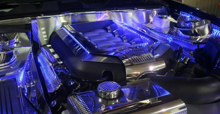 Illuminated engine cover lights up Mustang motor: chrome by day, blue by night