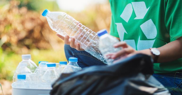 Nextek-Recycling-Bottles-Hand-AdobeStock_320996786.jpg