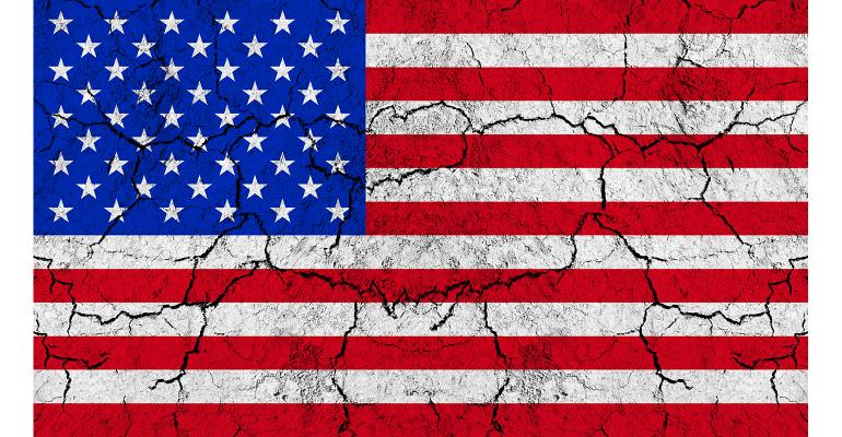US flag with fissures and fractures
