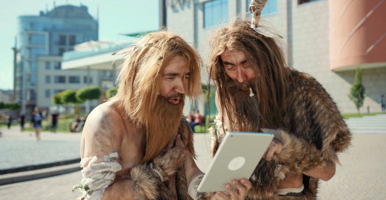 cavemen with laptop computer