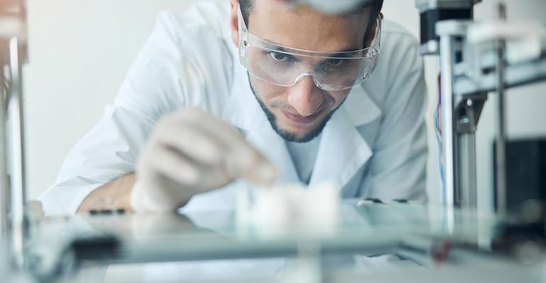 engineer examining 3D object
