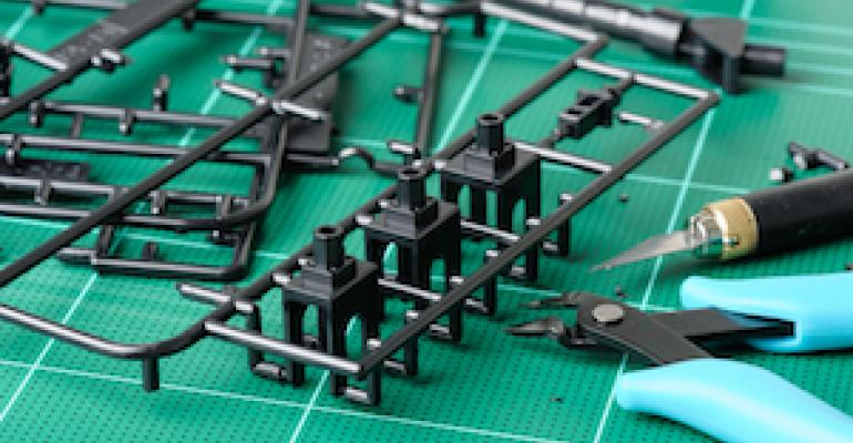 Sprue injection molded part