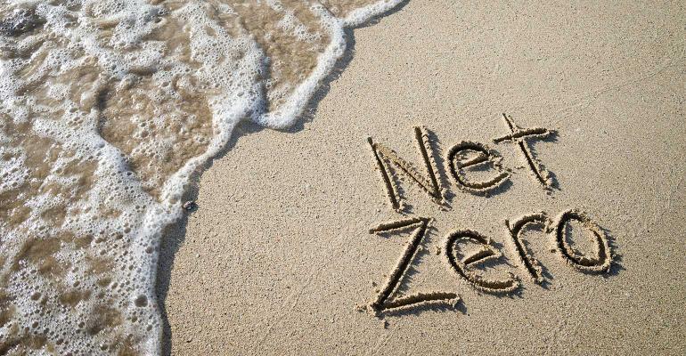 net zero written in sand on beach