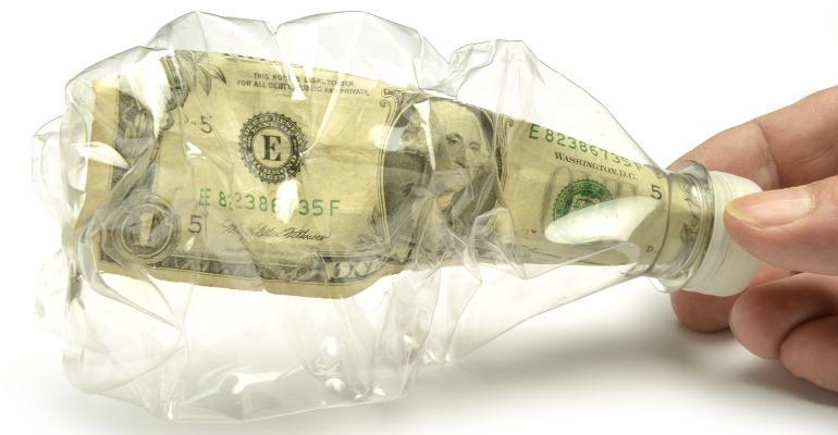 dollar bill in plastic bottle