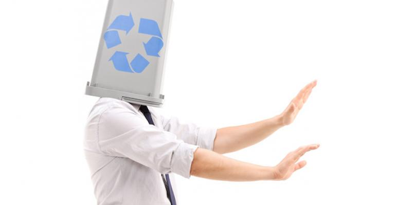 confused man with recycling bin on head