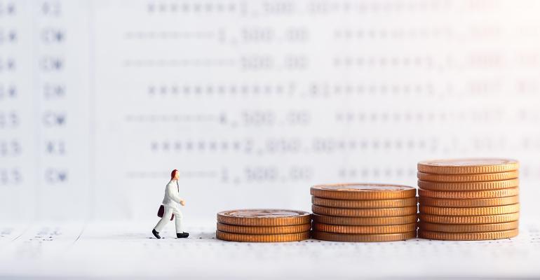 businessman walking on rising coins