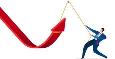 downward arrow forced upward by businessman